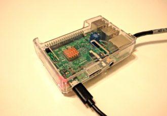 A raspberry pi device inside a clear case